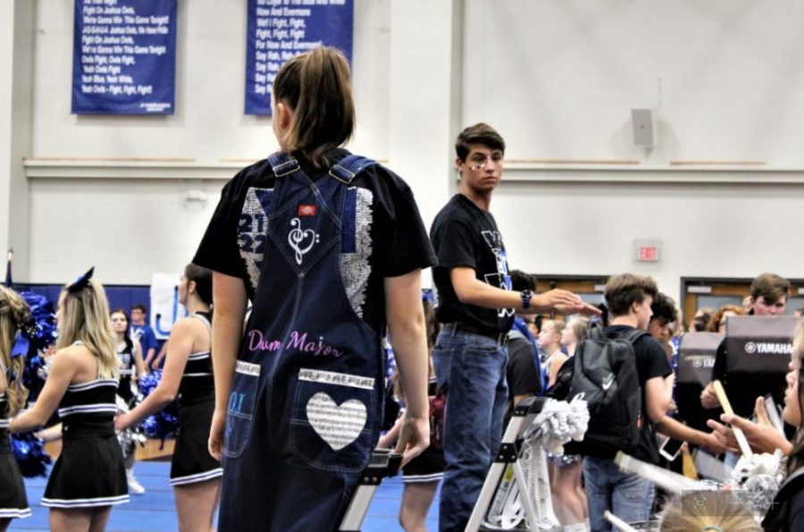 Josh Bischops and Lillie Couey conducting the band in the 2021 homecoming pep rally.